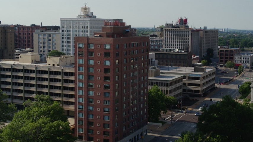 5.7K aerial video of a stationary view of brick office building before approach in Downtown St. Louis, Missouri Aerial Stock Footage | DX0001_000801