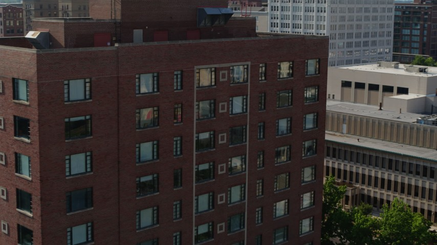5.7K aerial video of a slow approach to a brick office building in Downtown St. Louis, Missouri Aerial Stock Footage | DX0001_000802