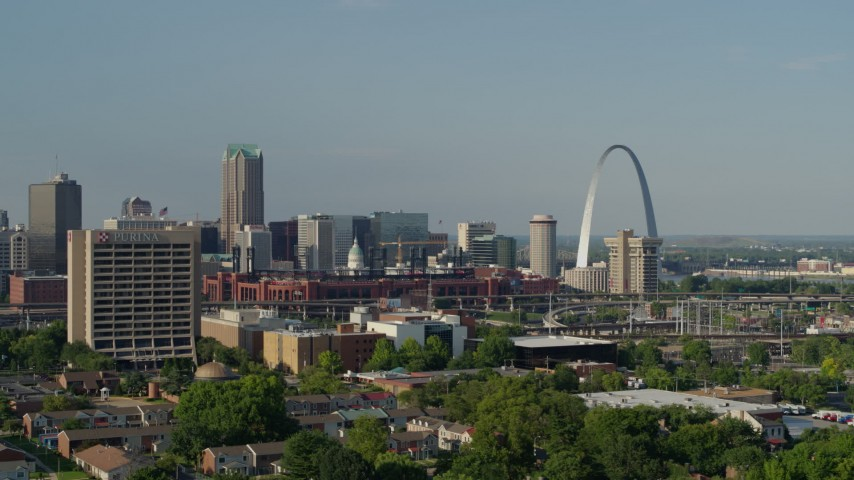 5.7K stock footage aerial video of office building and stadium near the Gateway Arch in Downtown St. Louis, Missouri Aerial Stock Footage | DX0001_000810
