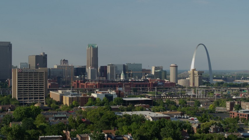 5.7K stock footage aerial video of an office building and stadium near the Gateway Arch in Downtown St. Louis, Missouri Aerial Stock Footage | DX0001_000815