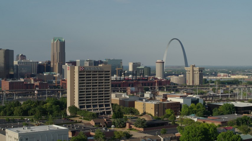 5.7K aerial video fly away from office building and by stadium near Gateway Arch in Downtown St. Louis, Missouri Aerial Stock Footage | DX0001_000817
