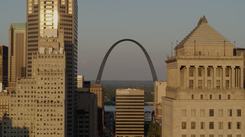 5.7K stock footage aerial video flyby courthouse to reveal Gateway Arch at sunset, Downtown St. Louis, Missouri Aerial Stock Footage | DX0001_000838