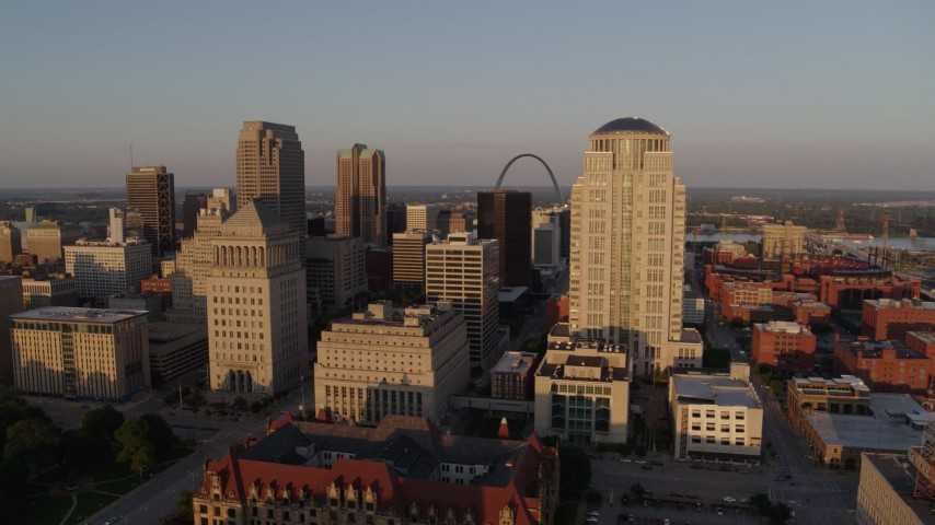 5.7K aerial video of flying by courthouses to reveal Gateway Arch and museum at sunset, Downtown St. Louis, Missouri Aerial Stock Footage | DX0001_000845