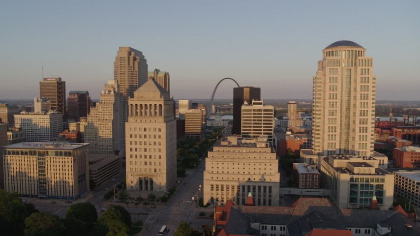 5.7K aerial video flyby courthouse buildings and reveal Arch and museum at sunset, Downtown St. Louis, Missouri Aerial Stock Footage | DX0001_000849