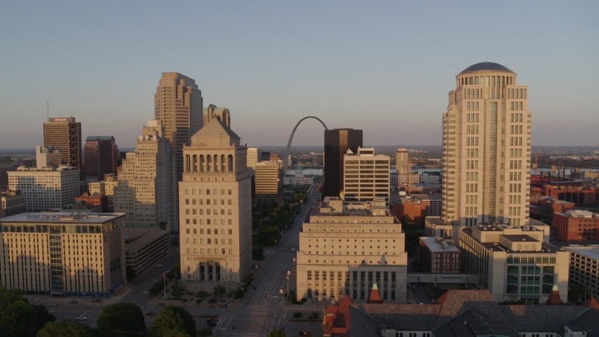 5.7K stock footage aerial video flyby the courthouse buildings to reveal Arch and museum at sunset, Downtown St. Louis, Missouri Aerial Stock Footage | DX0001_000852