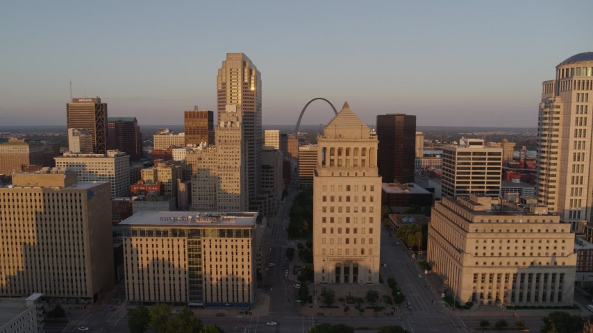 5.7K aerial video fly away from courthouse with Arch in background at sunset, Downtown St. Louis, Missouri Aerial Stock Footage | DX0001_000856