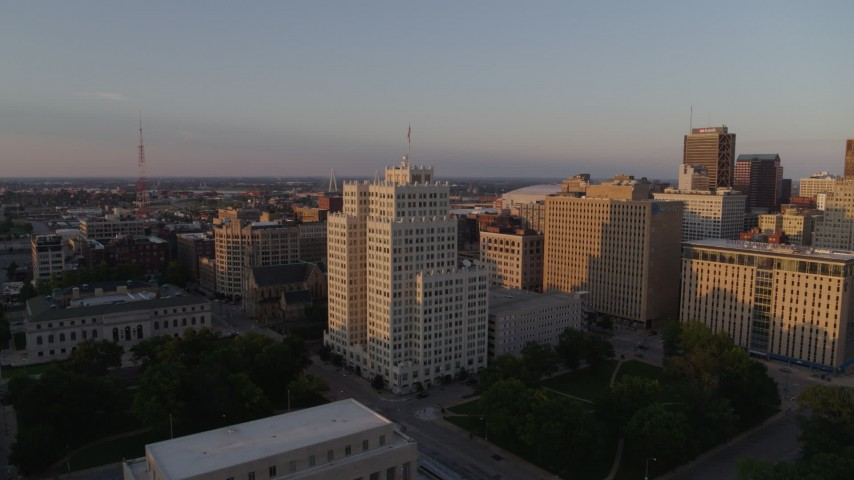 5.7K stock footage aerial video fly away from a tall apartment building, reveal museum at sunset, Downtown St. Louis, Missouri Aerial Stock Footage | DX0001_000857