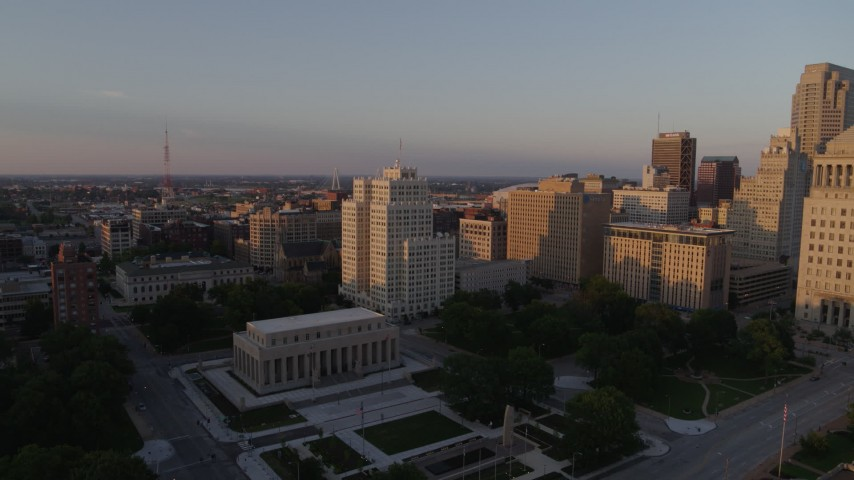 5.7K aerial video fly over museum to approach a tall apartment building at sunset, Downtown St. Louis, Missouri Aerial Stock Footage | DX0001_000858