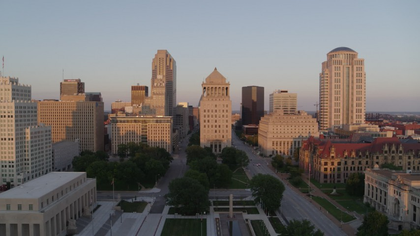 5.7K aerial video of a reverse view of downtown courthouse buildings at sunset, Downtown St. Louis, Missouri Aerial Stock Footage | DX0001_000861