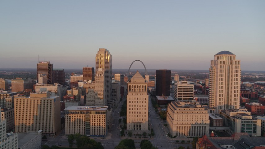 5.7K stock footage aerial video of flying away from the courthouses and downtown at sunset, Downtown St. Louis, Missouri Aerial Stock Footage | DX0001_000864