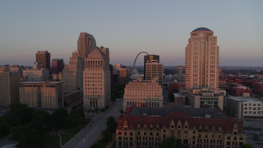5.7K stock footage aerial video of passing courthouses with view of the Arch, reveal city hall at sunset, Downtown St. Louis, Missouri Aerial Stock Footage | DX0001_000869