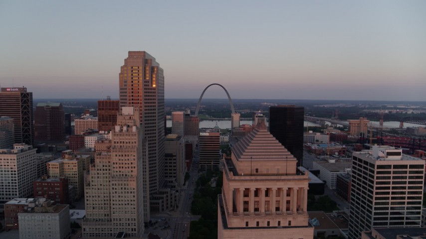 5.7K stock footage aerial video approach downtown courthouse and reveal the Arch at sunset, Downtown St. Louis, Missouri Aerial Stock Footage DX0001_000873