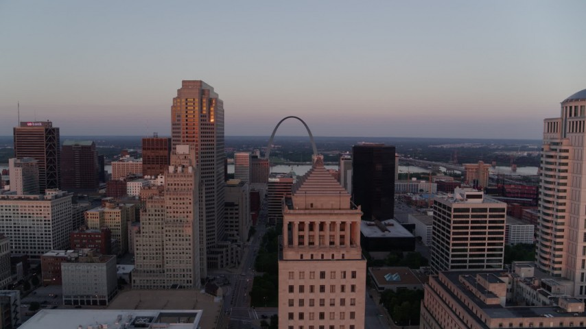 5.7K aerial video fly away from the Arch and downtown at sunset, Downtown St. Louis, Missouri Aerial Stock Footage | DX0001_000874