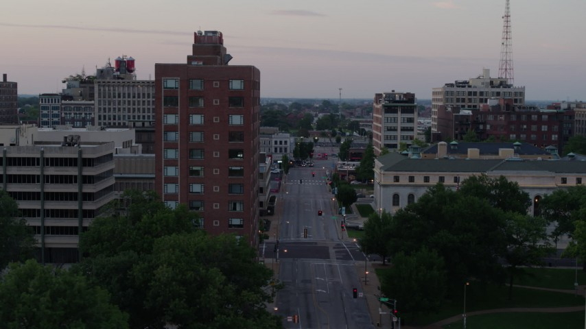 5.7K stock footage aerial video of passing an office building and an empty street at twilight, Downtown St. Louis, Missouri Aerial Stock Footage | DX0001_000878