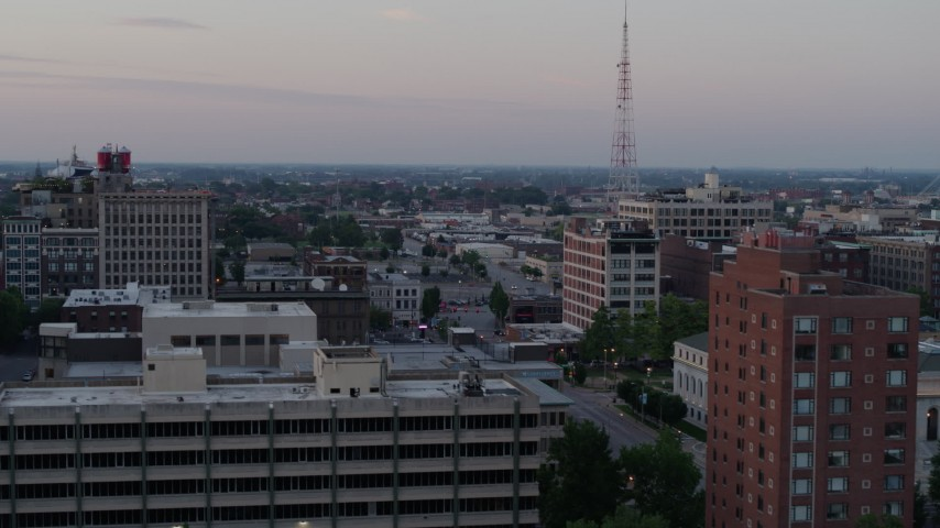 5.7K stock footage aerial video flyby brick office building for a wider view of neighborhood at twilight, Downtown St. Louis, Missouri Aerial Stock Footage | DX0001_000879