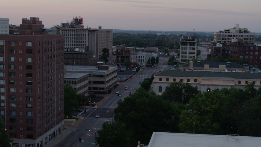 5.7K stock footage aerial video flyby brick office building to reveal light street traffic at twilight, Downtown St. Louis, Missouri Aerial Stock Footage | DX0001_000880