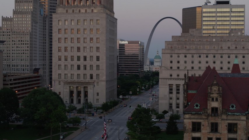 5.7K stock footage aerial video flyby courthouses, reveal light street traffic, the Gateway Arch at twilight, Downtown St. Louis, Missouri Aerial Stock Footage | DX0001_000883