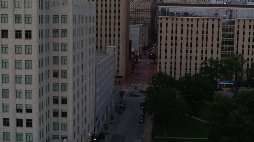 5.7K stock footage aerial video flyby office building to reveal city street at twilight, Downtown St. Louis, Missouri Aerial Stock Footage | DX0001_000884