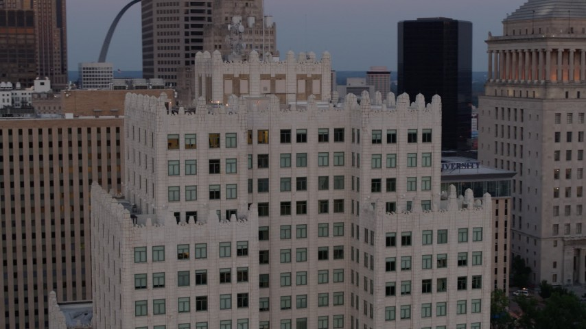 5.7K stock footage aerial video of circling the top of a downtown apartment building at twilight, Downtown St. Louis, Missouri Aerial Stock Footage | DX0001_000888