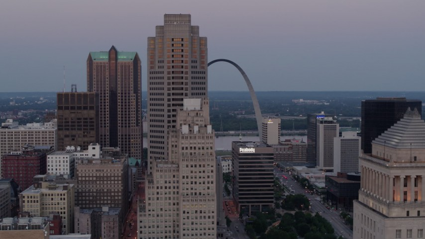 5.7K stock footage aerial video fly past skyscrapers with a view of the Gateway Arch at twilight, Downtown St. Louis, Missouri Aerial Stock Footage | DX0001_000890