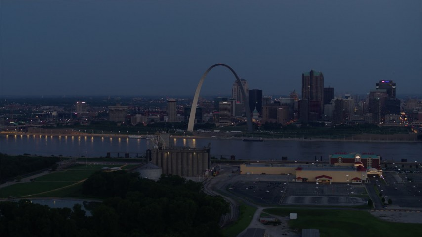 5.7K stock footage aerial video of the famous Gateway Arch at twilight, visible from across the Mississippi River, Downtown St. Louis, Missouri Aerial Stock Footage | DX0001_000896