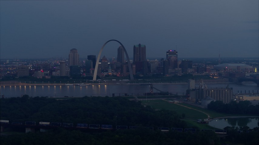 5.7K stock footage aerial video of the Gateway Arch and the Mississippi River at twilight, Downtown St. Louis, Missouri Aerial Stock Footage DX0001_000899 | Axiom Images