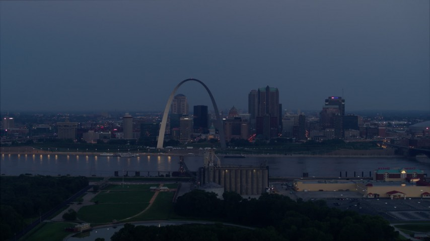 5.7K stock footage aerial video view across the river of the the Gateway Arch at twilight, Downtown St. Louis, Missouri Aerial Stock Footage | DX0001_000901