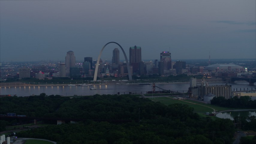 5.7K stock footage aerial video of the Gateway Arch and Downtown St. Louis, Missouri, across the river at twilight Aerial Stock Footage | DX0001_000906