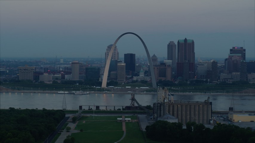 5.7K aerial video of the Gateway Arch and the skyline of Downtown St. Louis, Missouri, across the river at sunrise Aerial Stock Footage | DX0001_000921