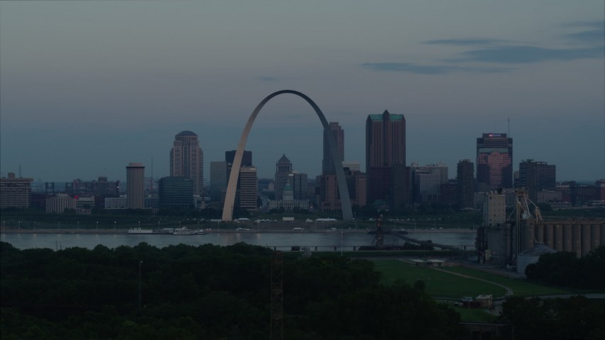 5.7K aerial video flyby the Arch and skyline in Downtown St. Louis, Missouri, by Mississippi River at sunrise Aerial Stock Footage | DX0001_000926