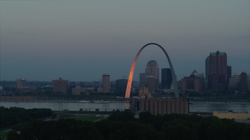 5.7K stock footage aerial video of the Gateway Arch reflecting sunlight in Downtown St. Louis, Missouri, at sunrise Aerial Stock Footage | DX0001_000928