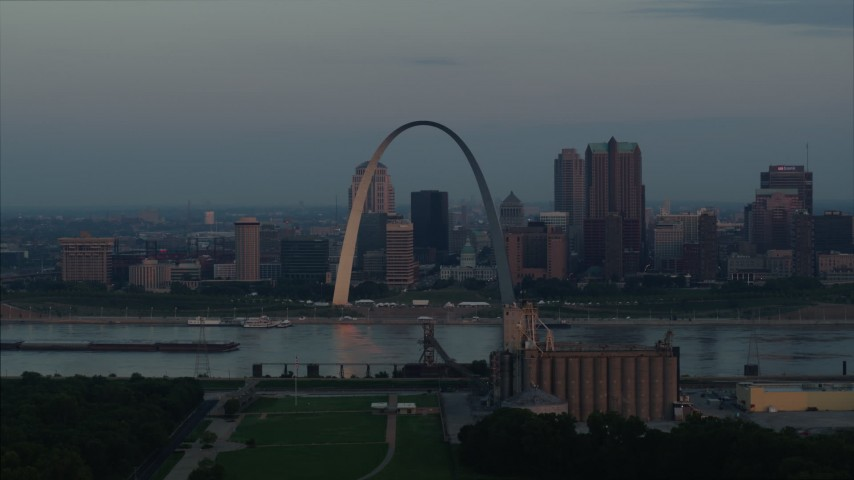 5.7K stock footage aerial video of the riverfront Gateway Arch in Downtown St. Louis, Missouri, at sunrise Aerial Stock Footage | DX0001_000930