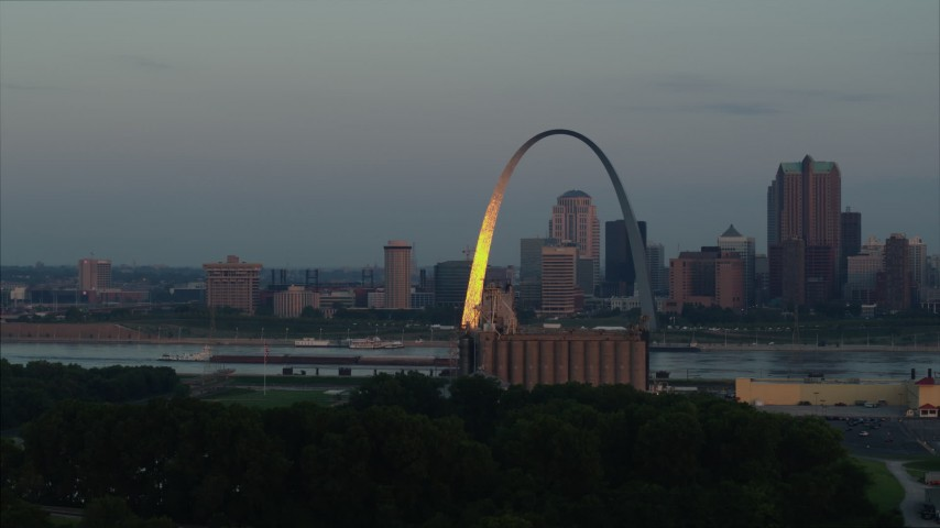 5.7K aerial video the Gateway Arch reflecting bright morning sunlight in Downtown St. Louis, Missouri Aerial Stock Footage DX0001_000934