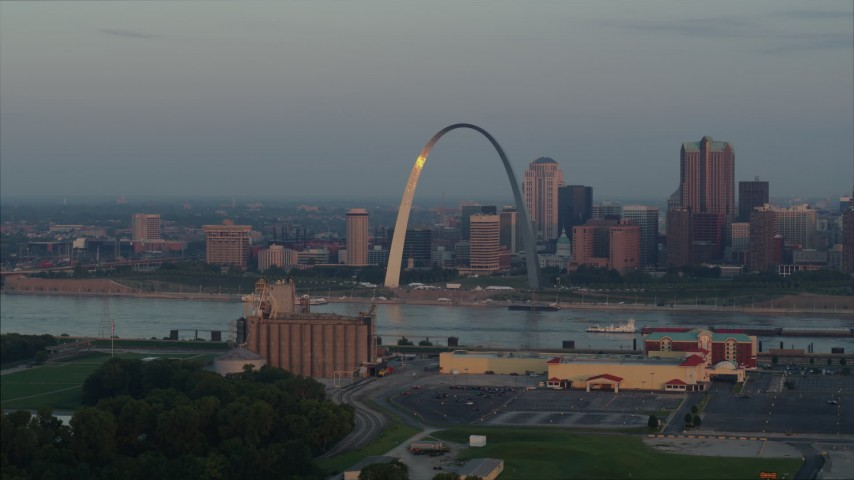 5.7K stock footage aerial video of sunlight on the St. Louis Arch by the Mississippi River at sunrise in Downtown St. Louis, Missouri Aerial Stock Footage | DX0001_000940