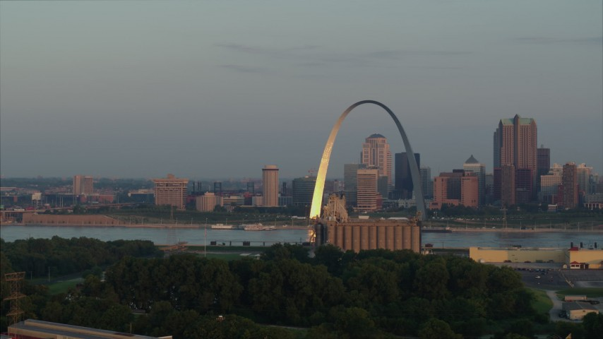5.7K stock footage aerial video flyby the St. Louis Arch at sunrise in Downtown St. Louis, Missouri Aerial Stock Footage | DX0001_000947