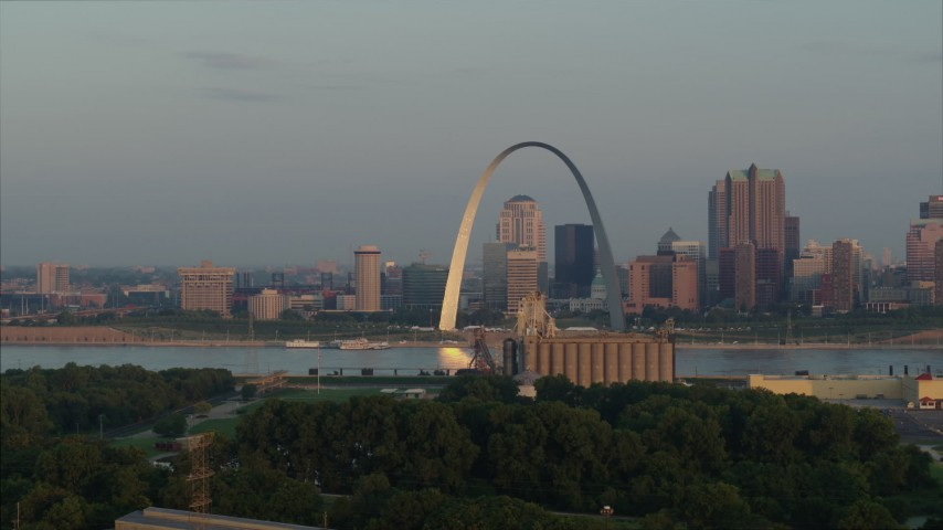 5.7K aerial video flyby the St. Louis Arch in the morning while descending in Downtown St. Louis, Missouri Aerial Stock Footage | DX0001_000950