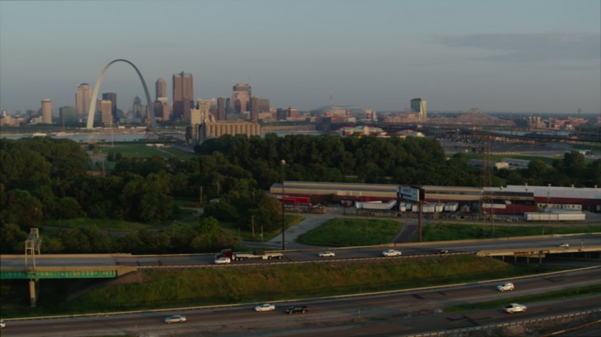 5.7K stock footage aerial video pan across I-55 to reveal the Gateway Arch in the morning, Downtown St. Louis, Missouri Aerial Stock Footage | DX0001_000957