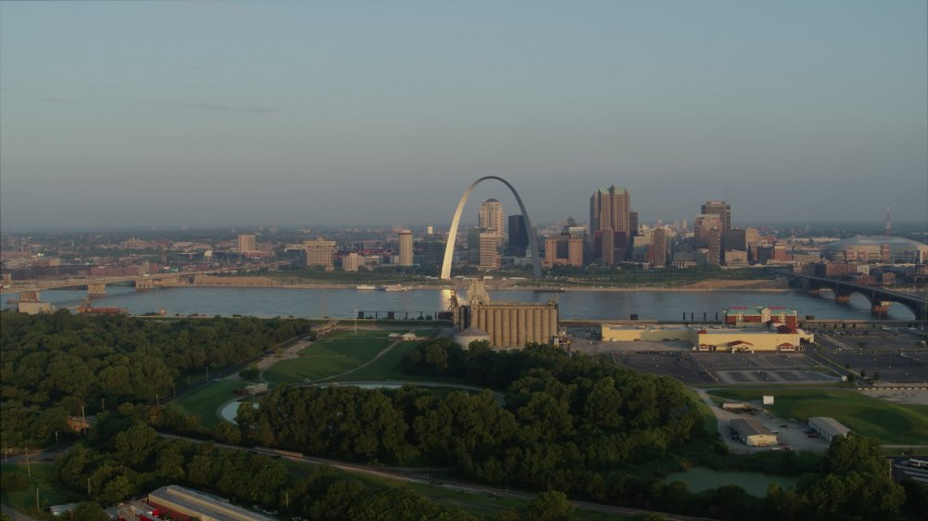 5.7K stock footage aerial video flyby grain elevator with view of the Gateway Arch in the morning, Downtown St. Louis, Missouri Aerial Stock Footage | DX0001_000962