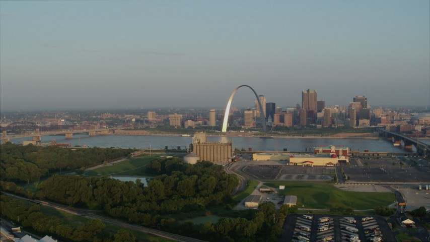 5.7K aerial video flyby grain elevator with view of the Gateway Arch in the morning, and descend, Downtown St. Louis, Missouri Aerial Stock Footage | DX0001_000963
