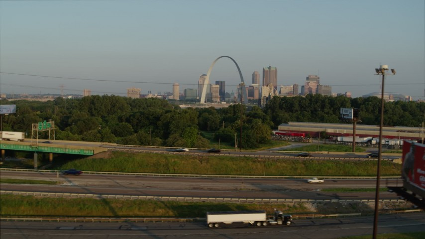 5.7K aerial video ascend from light traffic on I-55 for view of the Gateway Arch at sunrise, Downtown St. Louis, Missouri Aerial Stock Footage | DX0001_000970
