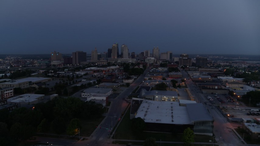5.7K stock footage aerial video of the distant city skyline at twilight in Downtown Kansas City, Missouri Aerial Stock Footage | DX0001_000973