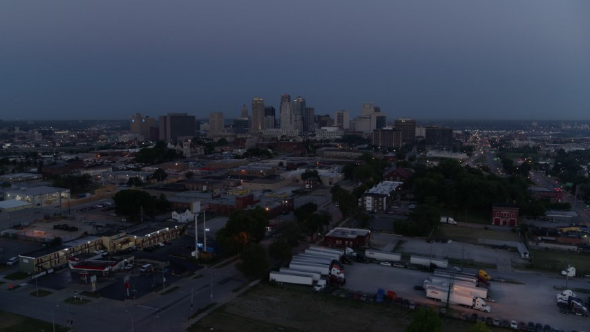 5.7K stock footage aerial video of passing by the city skyline at twilight in Downtown Kansas City, Missouri Aerial Stock Footage | DX0001_000975