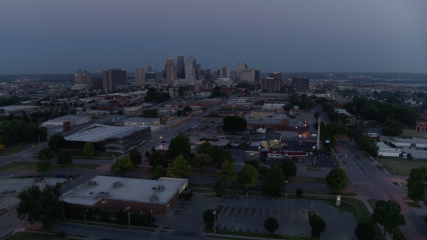 5.7K stock footage aerial video reverse view of the city skyline at twilight, seen from industrial area in Downtown Kansas City, Missouri Aerial Stock Footage | DX0001_000977