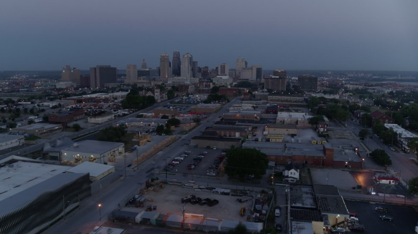 5.7K stock footage aerial video fly over industrial area to approach skyline at twilight, Downtown Kansas City, Missouri Aerial Stock Footage | DX0001_000978