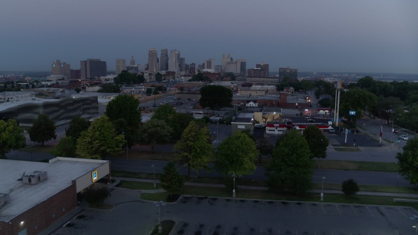 5.7K stock footage aerial video of a view of skyline at twilight while descending to parking lot, Downtown Kansas City, Missouri Aerial Stock Footage | DX0001_000980