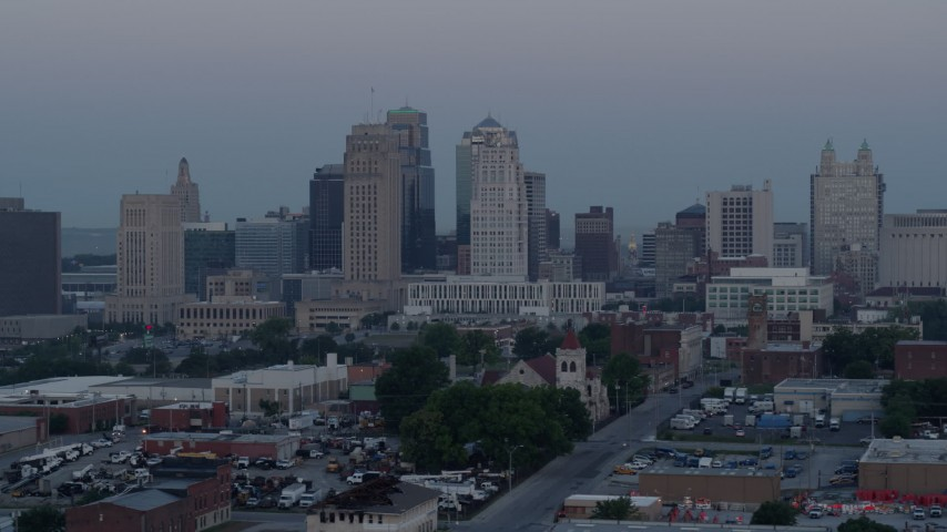 5.7K stock footage aerial video of passing the city's tall skyscrapers at twilight in Downtown Kansas City, Missouri Aerial Stock Footage   DX0001_000983