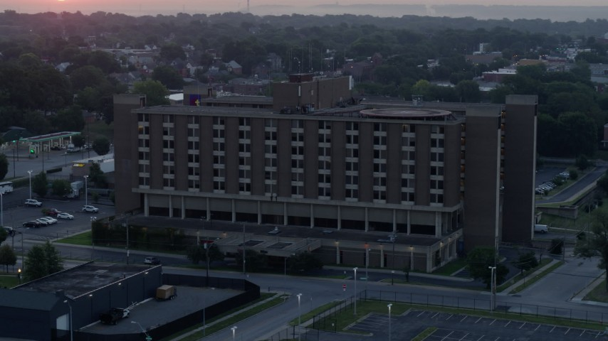 5.7K stock footage aerial video of orbiting a brick office building at sunrise in Kansas City, Missouri Aerial Stock Footage   DX0001_000990