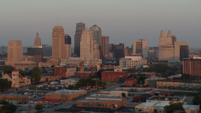 5.7K stock footage aerial video of passing by the city skyline at sunrise, Downtown Kansas City, Missouri Aerial Stock Footage | DX0001_000994