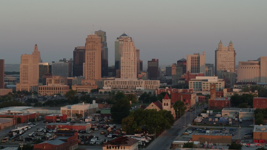 5.7K stock footage aerial video of flying by the city skyline at sunrise, Downtown Kansas City, Missouri Aerial Stock Footage | DX0001_000995