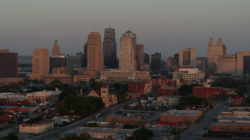 5.7K stock footage aerial video of approaching the city skyline at sunrise, Downtown Kansas City, Missouri Aerial Stock Footage | DX0001_000996